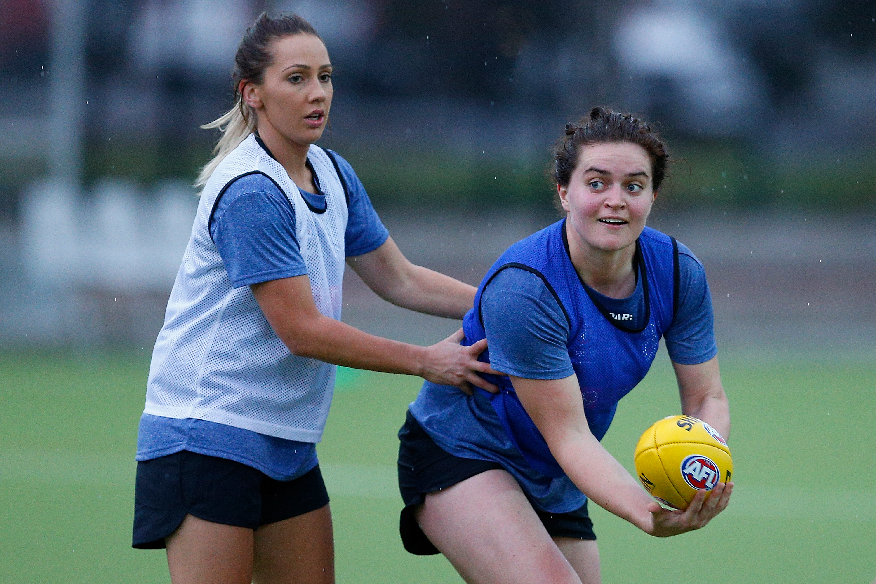 MELBOURNE, AUSTRALIA - NOVEMBER 22: Laura Bailey (L) and Meg McDonald (R) in action during the Western Bulldogs women's AFL training session at Maribyrnong College on November 22, 2016 in Melbourne, Australia. (Photo by Daniel Pockett/AFL Media/Getty Images)