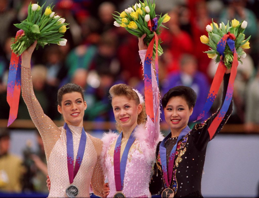 25 FEB 1994: OKSANA BAIUL OF THE UKRAINE 1ST (CENTER), NANCY KERRIGAN OF THE USA 2ND (LEFT) AND LU CHEN OF CHINA, 3RD, ON THE MEDAL STAND TODAY IN THE LADIES FIGURE SKATING COMPATITION AT THE 1994 WINTER OLYMPIC GAMES IN LILLEHAMMER. Mandatory Credit:Mike Powell/ALLSPORT