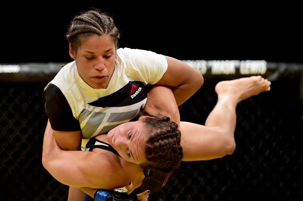 LAS VEGAS, NV - JULY 09: Cat Zingano (bottom) wrestles with Julianna Pena in their women's bantamweight bout during the UFC 200 event on July 9, 2016 at T-Mobile Arena in Las Vegas, Nevada. (Photo by Harry How/Zuffa LLC/Zuffa LLC via Getty Images)