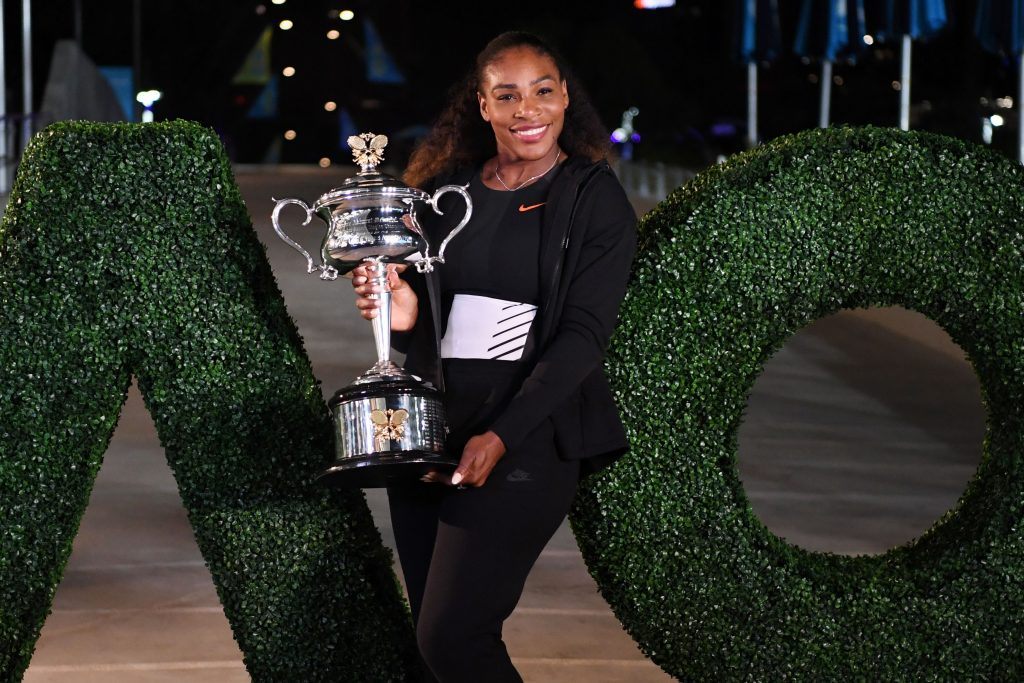 Serena Williams of the US poses with the championship trophy after her victory against Venus Williams of the US in the women's singles final on day 13 of the Australian Open tennis tournament in Melbourne on January 29, 2017. / AFP / SAEED KHAN / IMAGE RESTRICTED TO EDITORIAL USE - STRICTLY NO COMMERCIAL USE (Photo credit should read SAEED KHAN/AFP/Getty Images)
