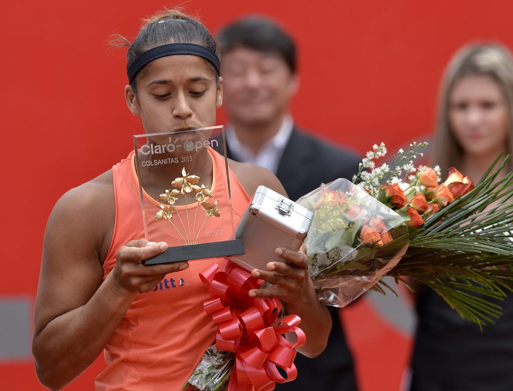 BOGOTA, COLOMBIA - APRIL 19: Teliana Pereira of Brazil kisses the trophy after winning a singles final match between Yaroslava Shvedova and Teliana Pereira as part of Claro Open Colsanitas WTA 2015 at El rancho Club on April 19, 2015 in Bogota, Colombia. (Photo by Gabriel Aponte/Vizzor/LatinContent/Getty Images)
