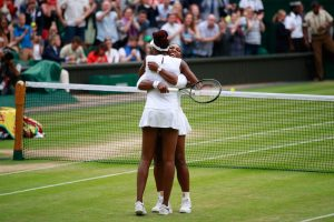 LONDON, ENGLAND - JULY 09: Venus Williams of The United States and Serena Williams of The United States celebrate victory in the Ladies Doubles Final against Timea Babos of Hungary and Yaroslava Shvedova of Kazakhstan on day twelve of the Wimbledon Lawn Tennis Championships at the All England Lawn Tennis and Croquet Club on July 9, 2016 in London, England. (Photo by Adam Pretty/Getty Images)