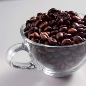 Still Life of Cup with Coffee Beans And White Background. (Photo by: Torri Leo/AGF/UIG via Getty Images)