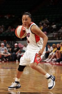 CHARLOTTE, NC - JULY 23: Dawn Staley #5 of the Charlotte Sting looks for an opening during the WNBA game against the Indiana Fever on July 23, 2005 at the Charlotte Coliseum in Charlotte, North Carolina. The Fever defeated the Sting 63-46. NOTE TO USER: User expressly acknowledges and agrees that, by downloading and or using this photograph, User is consenting to the terms and conditions of the Getty Images License Agreement. Mandatory Copyright Notice: Copyright 2005 NBAE (Photo by Kent Smith/NBAE via Getty Images)