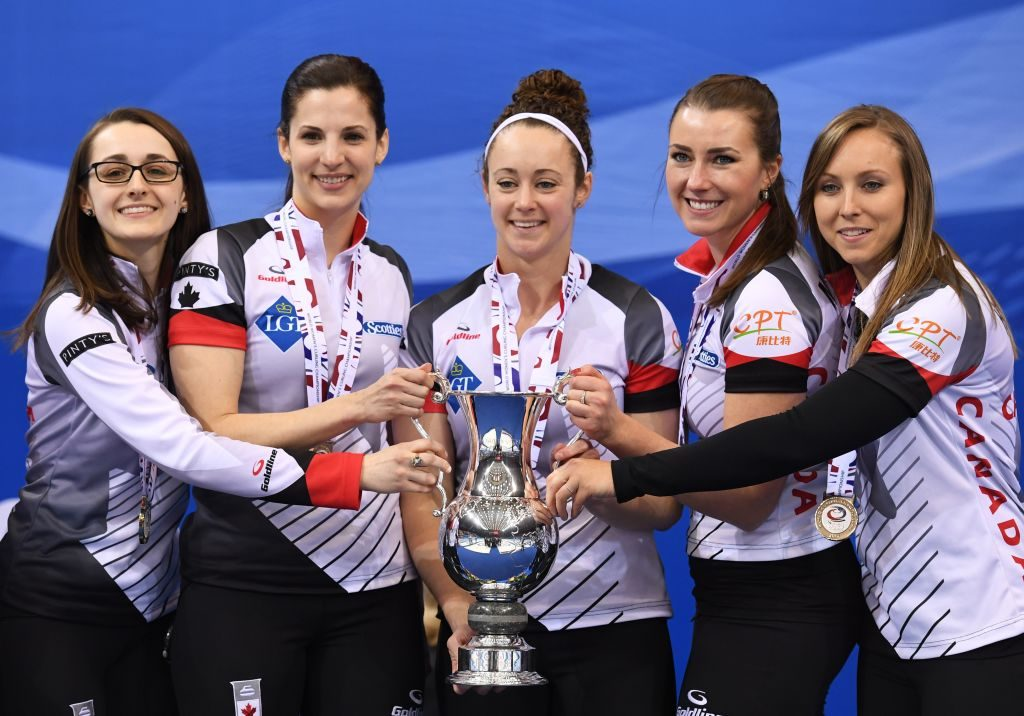 Canadian team members (from L) Cheryl Kreviazuk, Lisa Weagle, Joanne Courtney, Emma Miskew and Rachel Homan pose with the trophy after winning the gold medal at the Women's Curling World Championships in Beijing on March 26, 2017. / AFP PHOTO / GREG BAKER (Photo credit should read GREG BAKER/AFP/Getty Images)