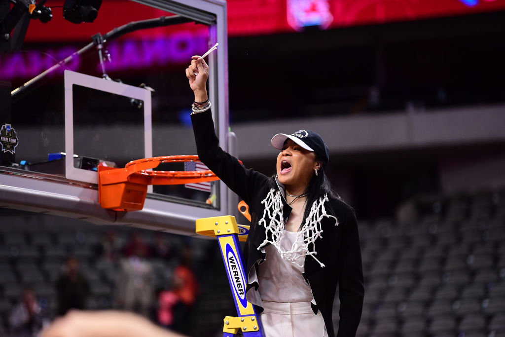 DALLAS, TX - APRIL 2: South Carolina Gamecocks head coach Dawn Staley, cuts the net down during the 2017 Women's Final Four at American Airlines Center on April 2, 2017 in Dallas, Texas. (Photo by Ben Solomon/NCAA Photos via Getty Images)