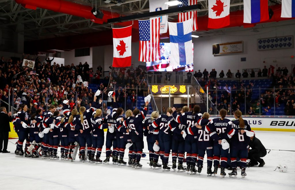 PLYMOUTH, MI - APRIL 07: The United States watches their flag rise after a 3-2 overtime win over Canada in the gold medal game at the 2017 IIHF Woman's World Championships at USA Hockey Arena on April 7, 2017 in Plymouth, Michigan. (Photo by Gregory Shamus/Getty Images)
