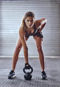 Shot of a young woman working out with kettlebellshttp://195.154.178.81/DATA/i_collage/pi/shoots/806021.jpg