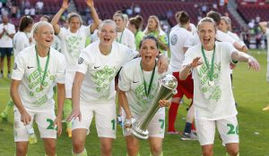 COLOGNE, GERMANY - MAY 27: Pernille Harder of Wolfsburg (L), Axandra Popp of Wolfsburg, (2.L), Sara Bjoerk Gunnarsdottir of Wolfsburg (2.R) and Caroline Graham Hansen of Wolfsburg celebrate the winning of the trophy during the Women's DFB Cup Final 2017 match between SC Sand and VFL Wolfsburg at RheinEnergieStadion on May 27, 2017 in Cologne, Germany. (Photo by Mika Volkmann/Bongarts/Getty Images)