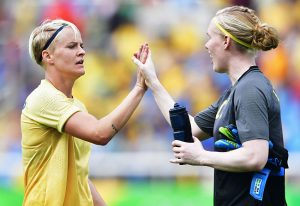 RIO DE JANEIRO, BRAZIL - AUGUST 03: Golal scorer Nilla Fischer of Sweden celebrates with Hedvig Lindahl during the Olympic Womens Football match between Sweden and South Africa during the at Olympic Stadium on August 3, 2016 in Rio de Janeiro, Brazil. (Photo by Stuart Franklin - FIFA/FIFA via Getty Images)