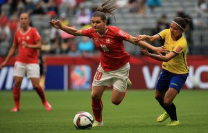 VANCOUVER, BC - JUNE 12: Ramona Bachmann of Switzerland and Angie Ponce of Ecuador challenge for the ball during the FIFA Women's World Cup 2015 Group C match between Switzerland and Ecuador at BC Place Stadium on June 12, 2015 in Vancouver, Canada. (Photo by Matthew Lewis - FIFA/FIFA via Getty Images)