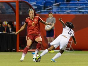 MONTREAL, QC - JUNE 09: Diana Saenz #5 of Costa Rica challenges Jennifer Hermoso #10 of Spain during the 2015 FIFA Women's World Cup Group E match at Olympic Stadium on June 9, 2015 in Montreal, Quebec, Canada. The final score between Spain and Costa Rica 1-1. (Photo by Minas Panagiotakis/Getty Images)